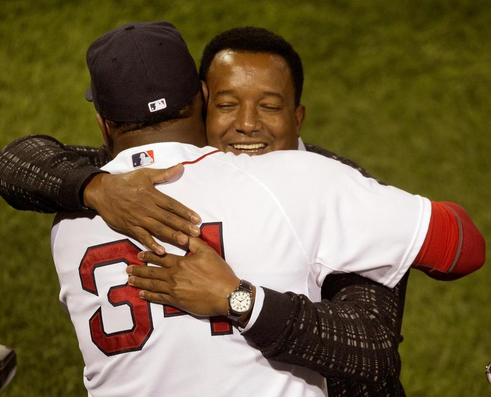 Hall of Famer Pedro Martinez hugged former teammate David Ortiz at a Fenway Park ceremony to honor Ortiz after he hit his 500th home run.
